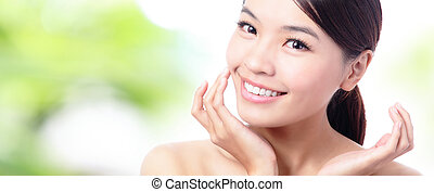 close up of Beauty woman Face and hand touch her face with...