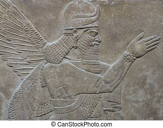 Ancient Assyrian wall carvings of a man