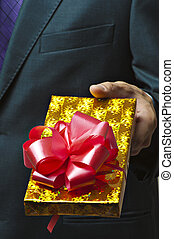 Male hands holding gift.