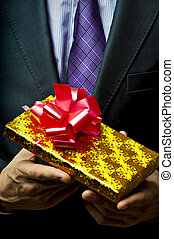 Male hand with gift.