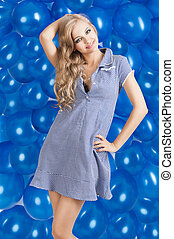 fashion shot of summer girl in blue, she has a funny expression