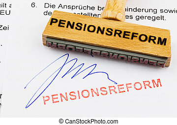 wooden stamp on the document: pension reform - a stamp made...