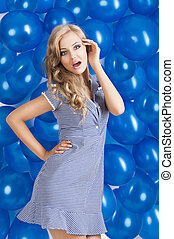 fashion shot of summer girl in blue, she has the right hand on t