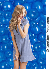 fashion shot of summer girl in blue, she has an expression of su
