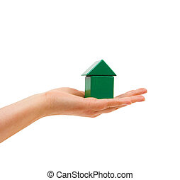 The woman's hand a symbolic energy-efficient house holds.