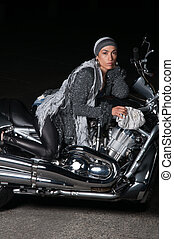 Fashion Biker Girl - Beautiful biker model posing with...