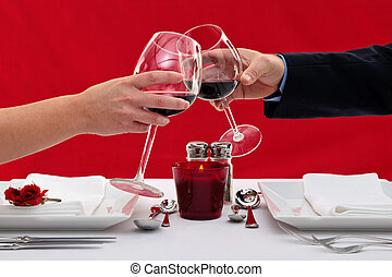 Couple toasting their glasses - Photo of the hands of a...