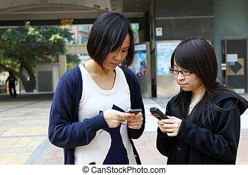 Asian woman using mobile phone