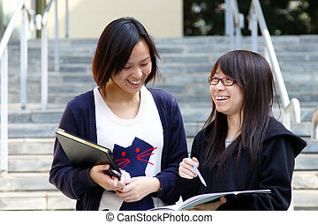 Asian students studying and discussing in university