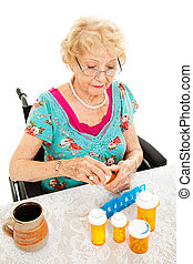 Disabled Woman Takes Medicine - Disabled senior woman in a...