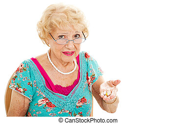Senior Woman Hates Taking Pills - Senior woman holding a...