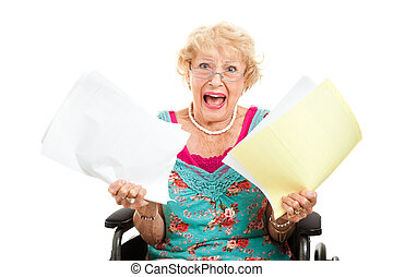 Frustrated by Medical Bills - Disabled senior woman...