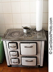 old wood stove in a kitchen of a house in the mountains