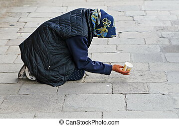 beggar asks for alms on the street