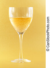 Sparkling wine - Wine glass with sparkling drink on yellow...