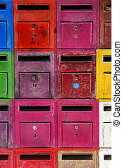 Colorful mailboxes - background of colorful old and rusty...