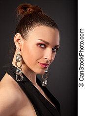 Portrait of beautiful woman with cute earrings