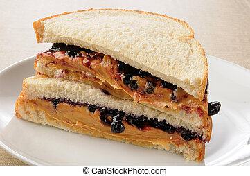 Peanut butter and jelly sandwich - A sliced peanut butter...