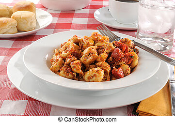 Tortellini - Bowl of tortellini with roasted tomato pesto