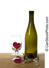 WIne bottle on a table with glasses and hearts - A wine...