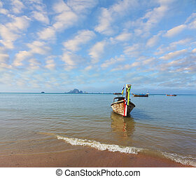 Beautifully decorated Native Longtail boat - A gentle warm...