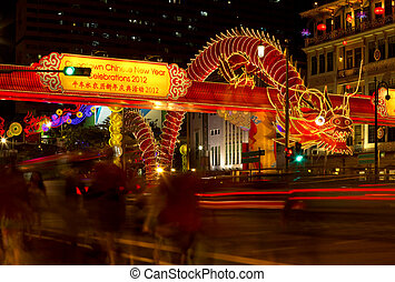 Giant dragon, pedestrian blur - Traffic light trails with...