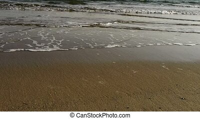 waves on sandy beach,bubble and blister on sand.