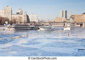 iceboats and fisherman on frozen Moscow river in sunny...