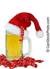 santa hat on beer mug - Santa hat on a beer mug with ribbon.