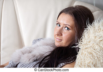 woman relaxing on couch in livingroom