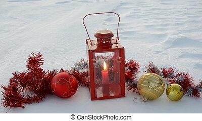 christmas balls and lamp on snow