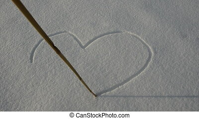 drawing Valentine hearts on snow