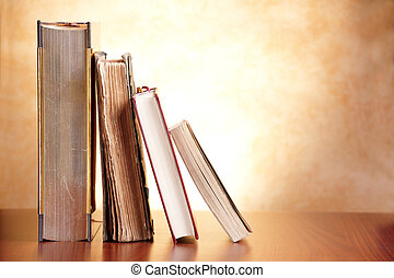 Old books on the wooden table