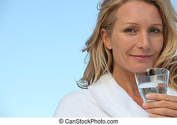 Attractive blonde haired woman with no make up on and...