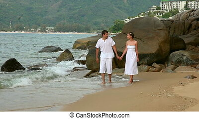 Couple. - Happiness couple walking on a beach.