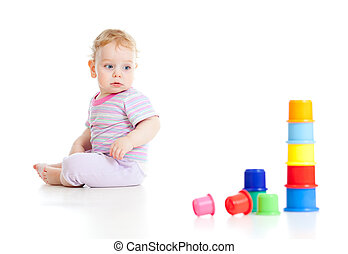 Cute little boy building tower from colorful cups isolated...