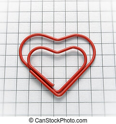 Heart shaped paper clip - Closeup of heart shaped red paper...