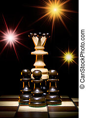 Fortune - Chess (queen and pawns) on a chess board. An art...