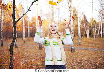 girl with maple leaves - beautiful young blond woman...