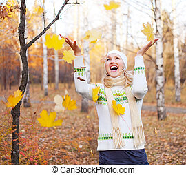 woman with maple leaves - beautiful young blond woman...