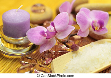 Healthy living - Spa treatment concept; candle, purple...