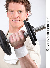 Man lifting dumbbell