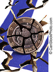 coin - A broken Greek coin on the Greek flag