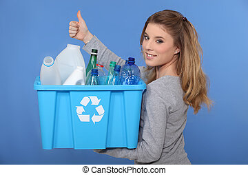 Woman recycling empty bottles