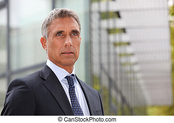 Serious senior businessman
