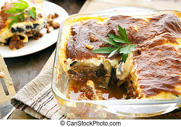 Moussaka - Home-made Greek moussaka. Eggplant layered with...