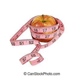 apple with measuring tape around - fresh apple with...
