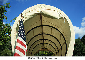 Covered Wagon With Flag - Covered wagon upclose with an...