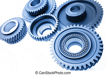 Cogwheels - Group of cogwheels binding together