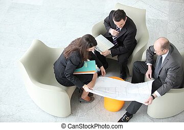 Businesspeople having a meeting, top view